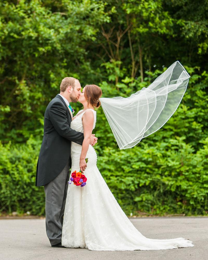 Sheffield wedding photographers, Tankersley Manor , bride veil blowing