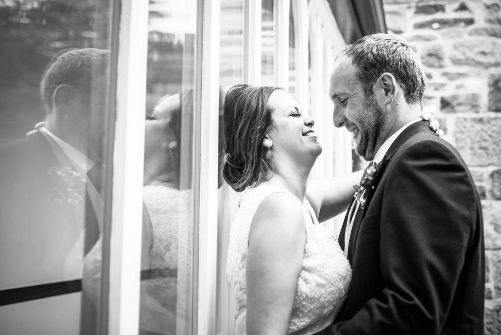 Laughing couple, Sheffield wedding photographers, Tankersley Manor