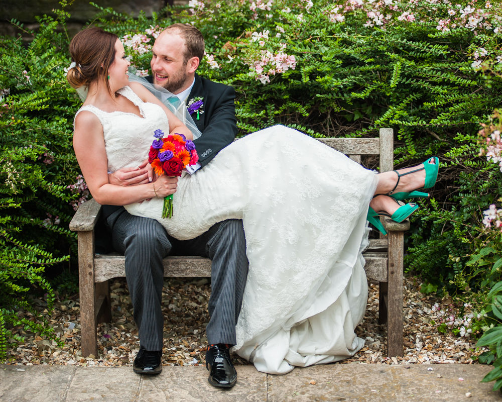 Bride and groom on bench, Sheffield wedding photographers, Tankersley Manor