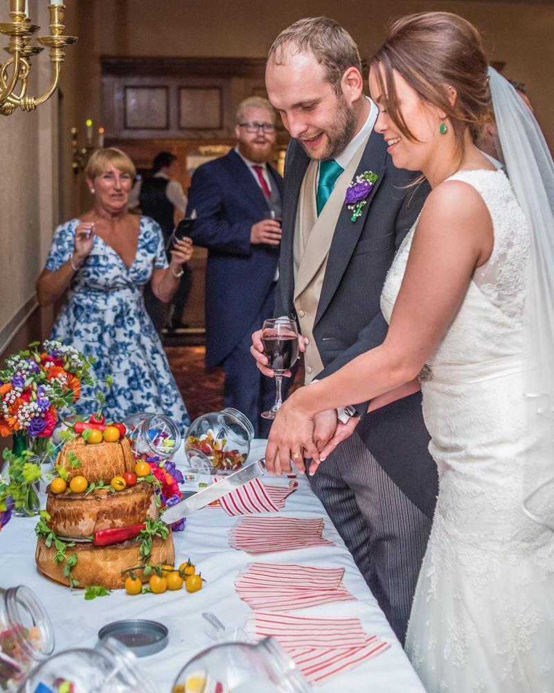 Bride and groom cutting cake, Sheffield wedding photographers, Tankersley Manor