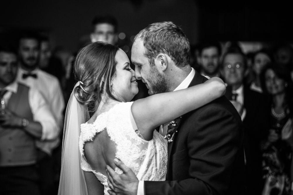 Snuggles on dancefloor, Sheffield wedding photographers, Tankersley Manor
