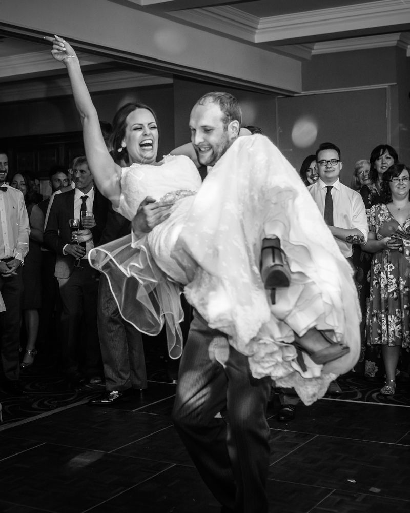 Groom picking up bride, Sheffield wedding photographers, Tankersley Manor