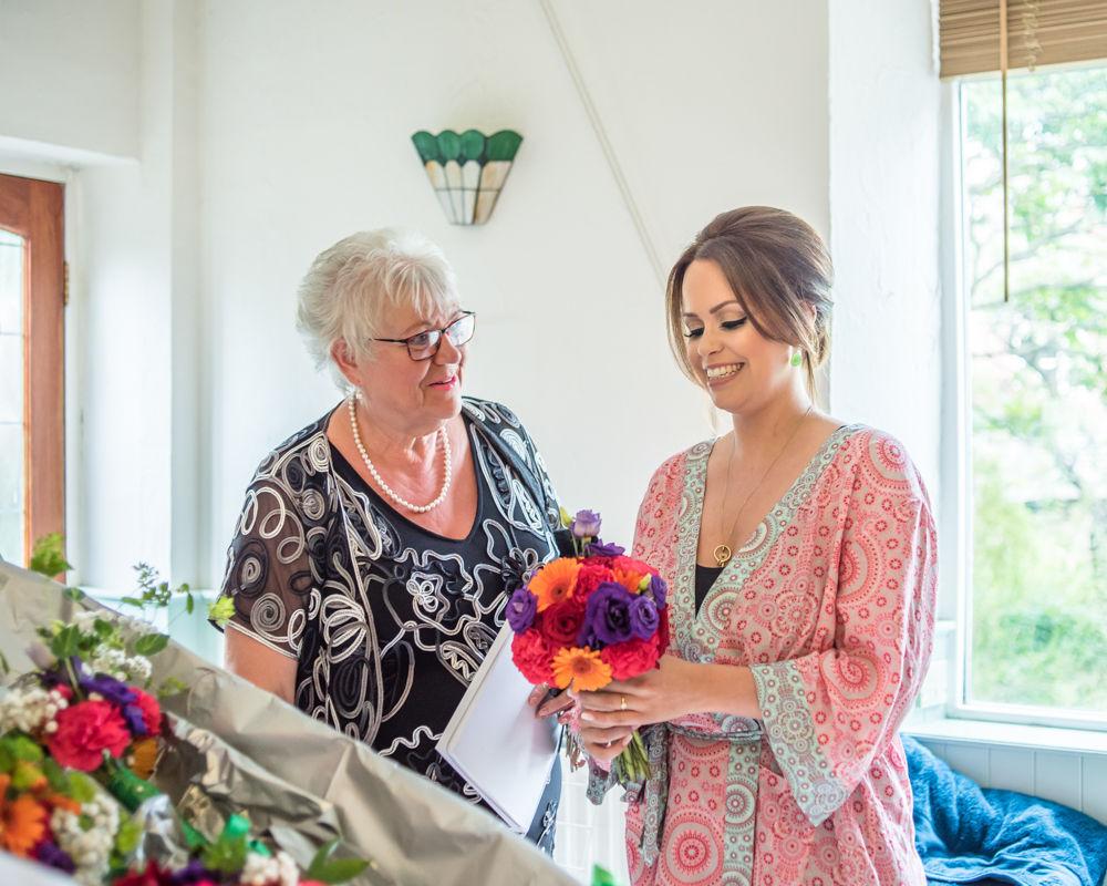 Sheffield wedding photographers, Bride receiving bouquet