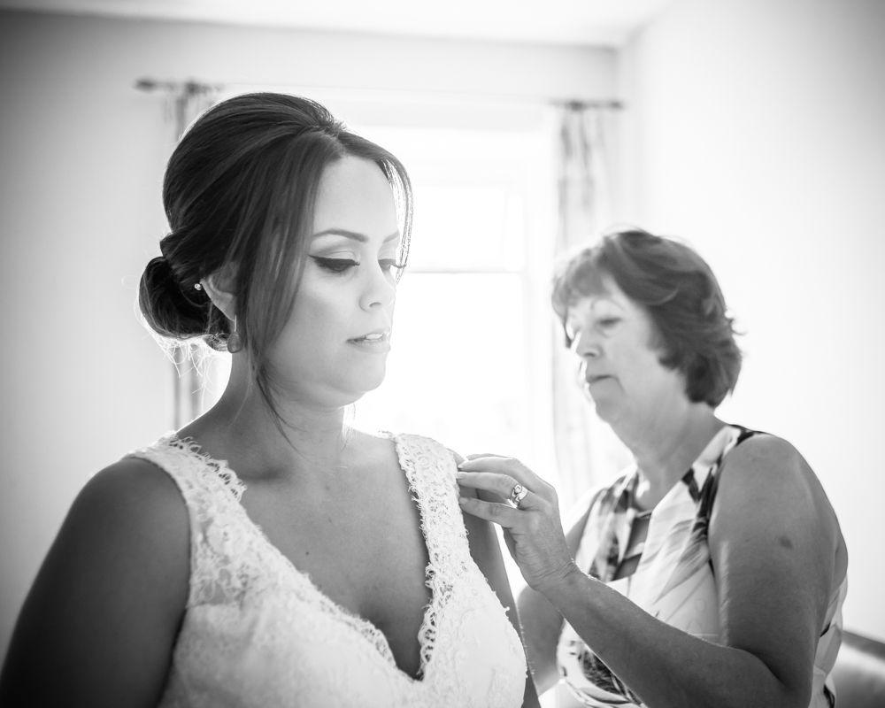 Sheffield wedding photographers, bride getting into dress