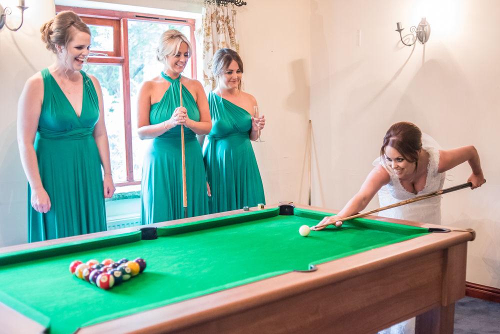Sheffield wedding photographers, Bride playing pool