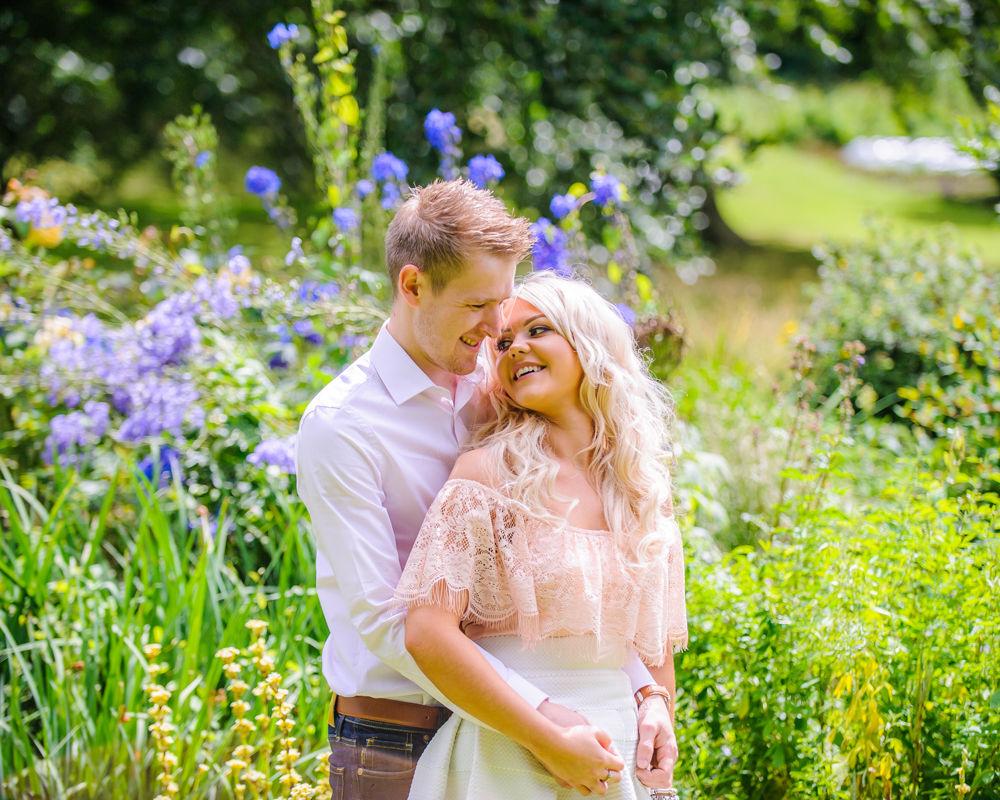 Cuddle in flowers, pre-wedding photos, Sheffield Botanical Gardens