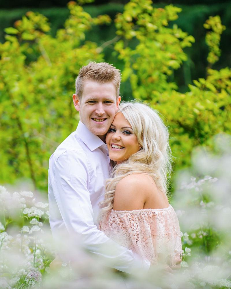 Smiling for camera, pre-wedding photos, Sheffield Botanical Gardens