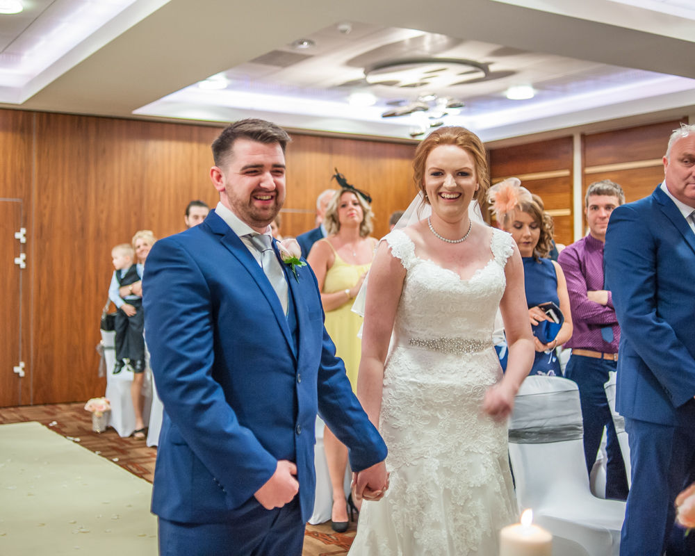 Bride and groom laughing in ceremony, Chesterfield wedding photographer, Casa Hotel