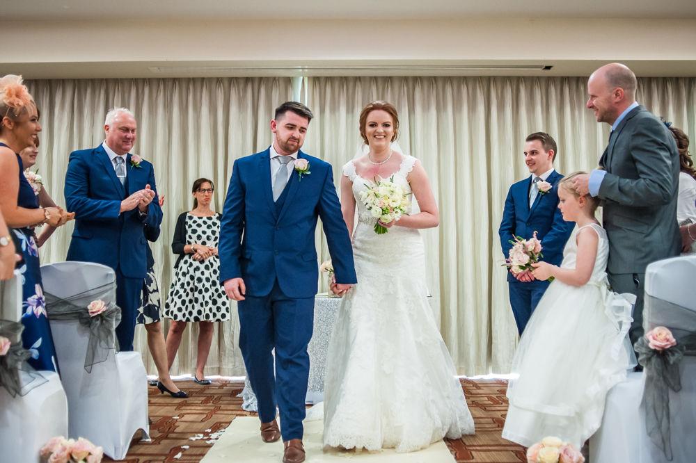 Walking down aisle, Chesterfield wedding photographer, Casa Hotel