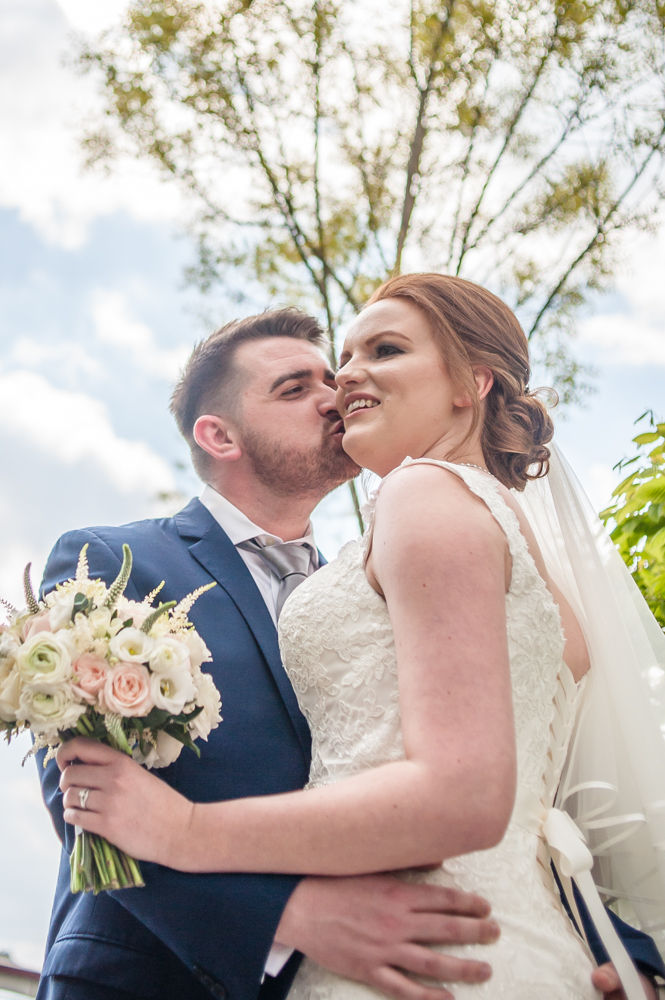 Kisses for bride, Chesterfield wedding photographer, Casa Hotel