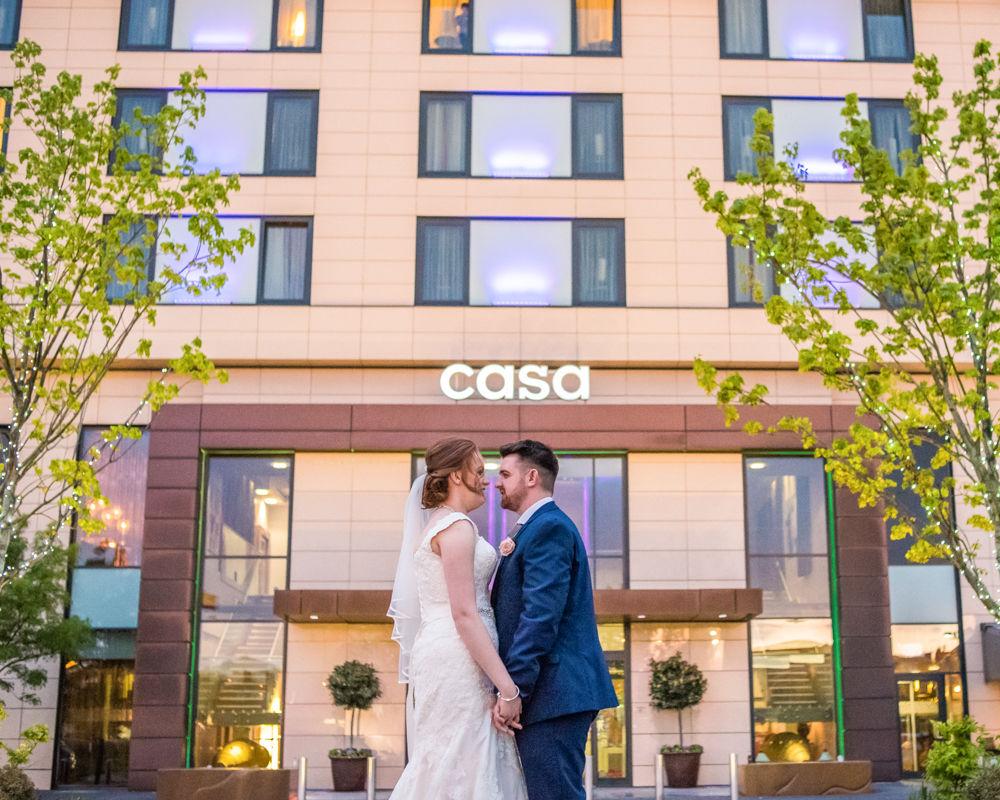 Kisses outside Casa Hotel, Chesterfield, Chesterfield wedding photographer, Casa Hotel