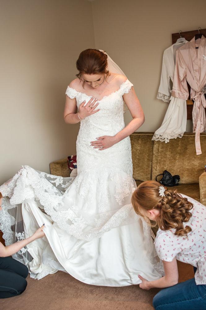 Bride getting dressed, Chesterfield wedding photographer, Casa Hotel