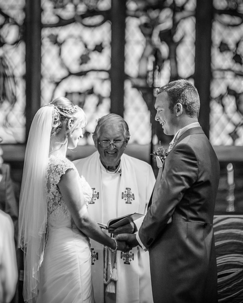 Exchanging vows in church, Sheffield wedding photographers, Smallshaw Farm Cottages