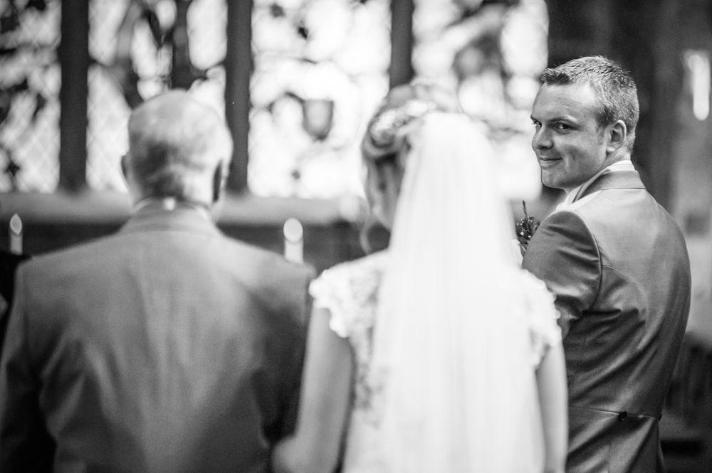 Groom seeing bride walking up aisle, Sheffield wedding photographers, Smallshaw Farm Cottages