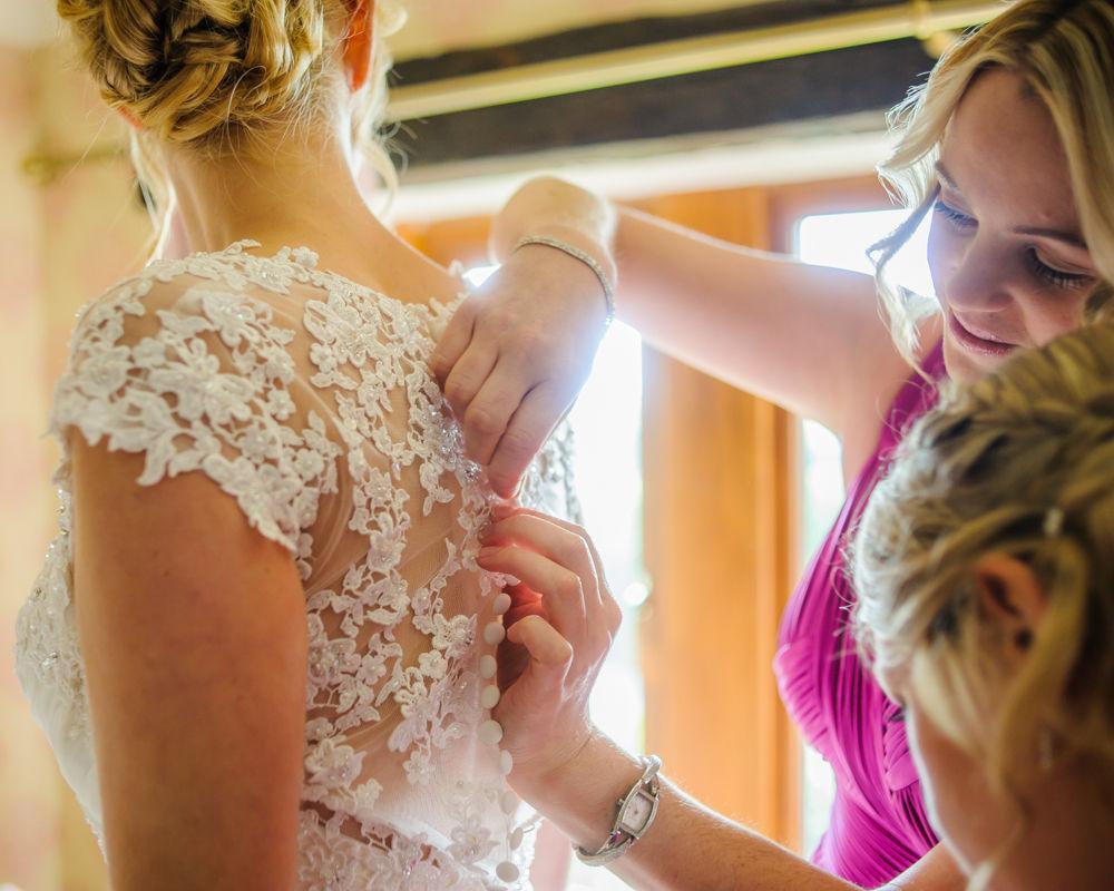 Brides dress details, Sheffield wedding photographers, Smallshaw Farm Cottages