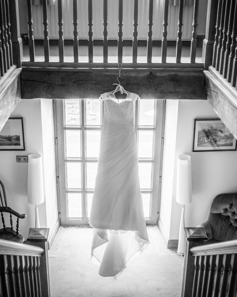 Brides dress hanging up, Sheffield wedding photographers, Smallshaw Farm Cottages
