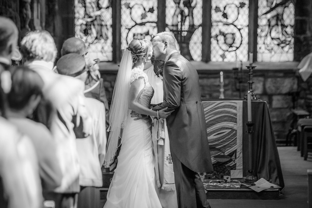 Bride and groom first kiss, Sheffield wedding photographers, Smallshaw Farm Cottages
