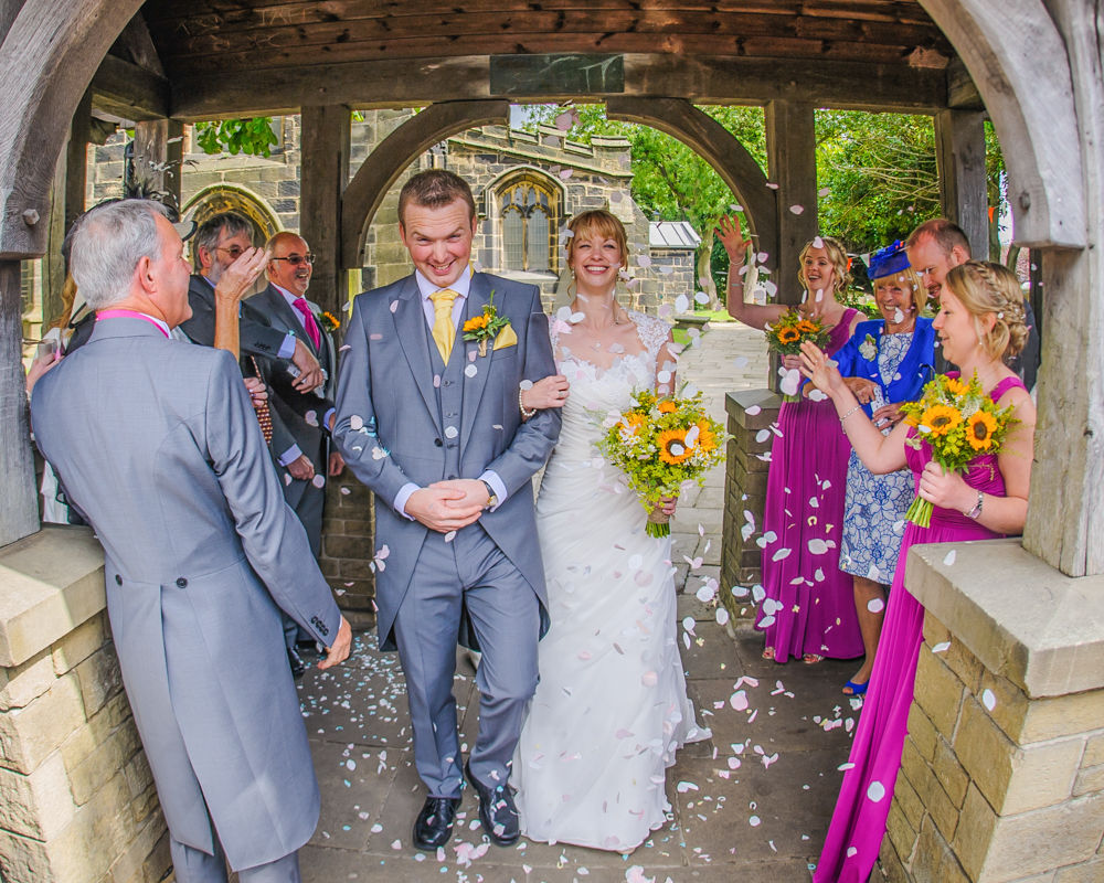 Bride and groom confetti at church, Sheffield wedding photographers, Smallshaw Farm Cottages