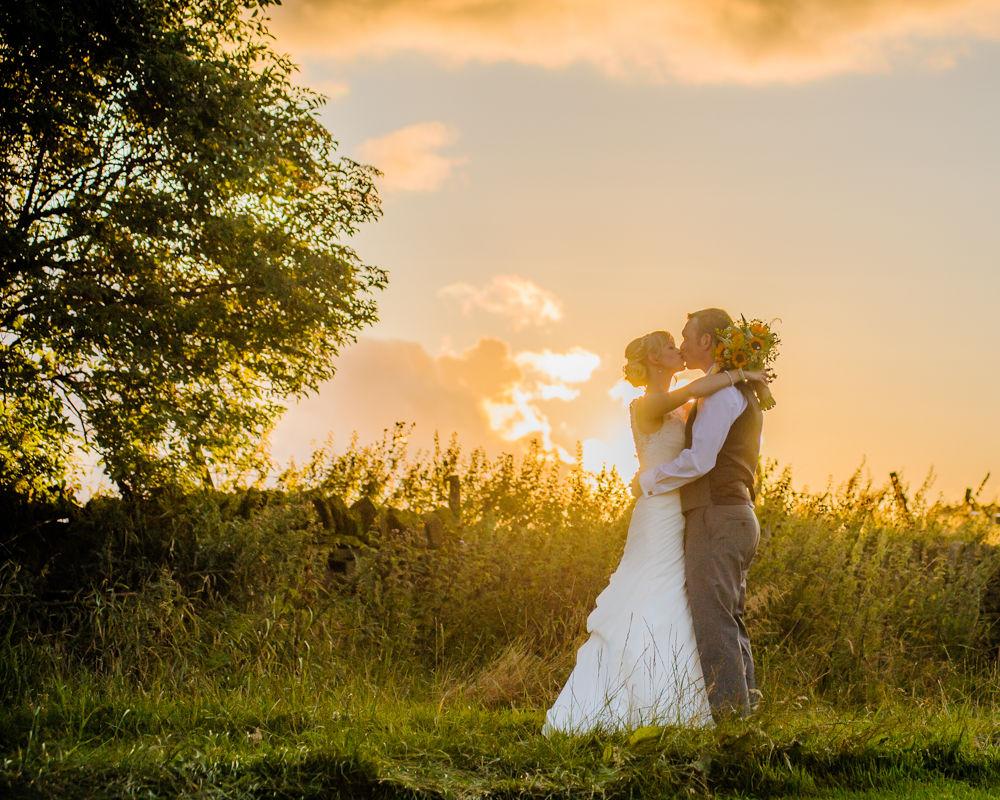 Bride and groom sunset kisses, Sheffield wedding photographers, Smallshaw Farm Cottages