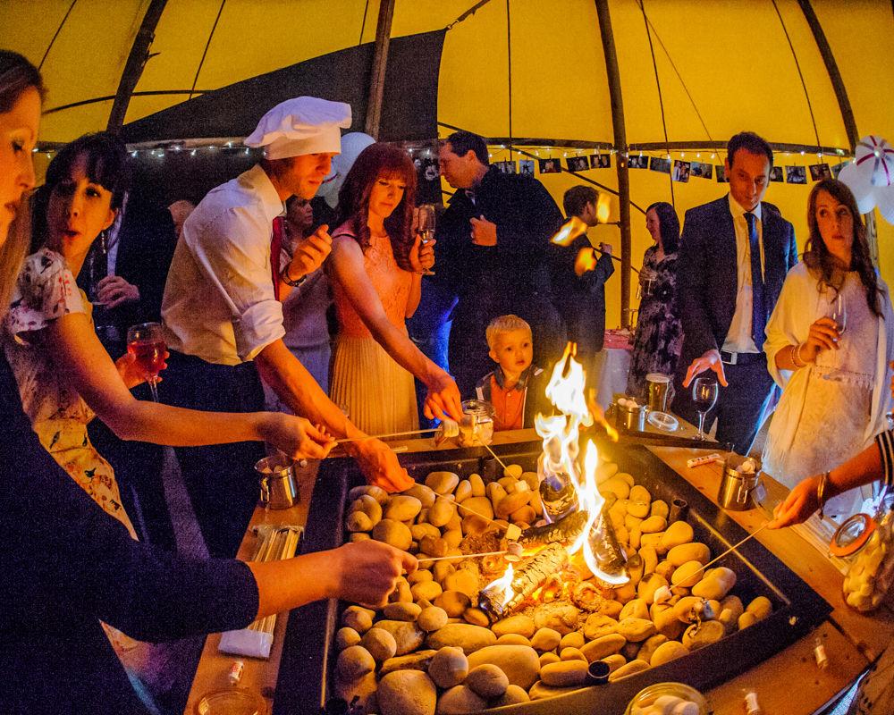 Toasting marshmallows. Sheffield wedding photographers, Smallshaw Farm Cottages