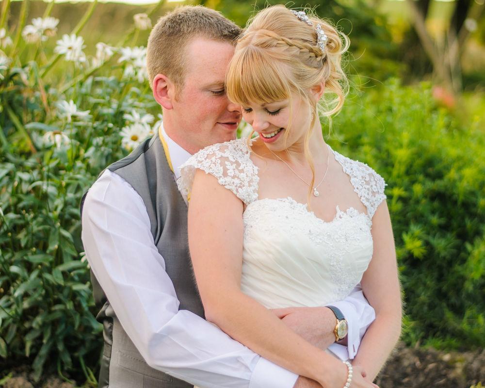 Bride and groom cuddles, Sheffield wedding photographers, Smallshaw Farm Cottages
