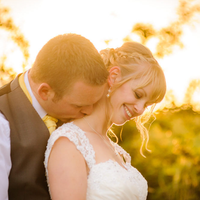 Bride and groom kisses, Sheffield wedding photographers, Smallshaw Farm Cottages
