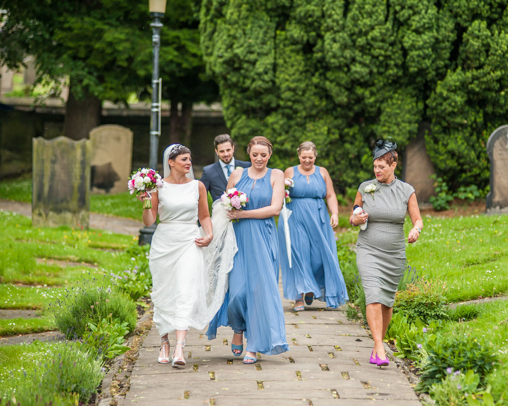 Bride and her squad walking to church, Sheffield wedding photographers