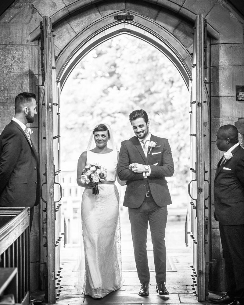 Bride and brother walking into church, St Mary's Ecclesfield, Sheffield