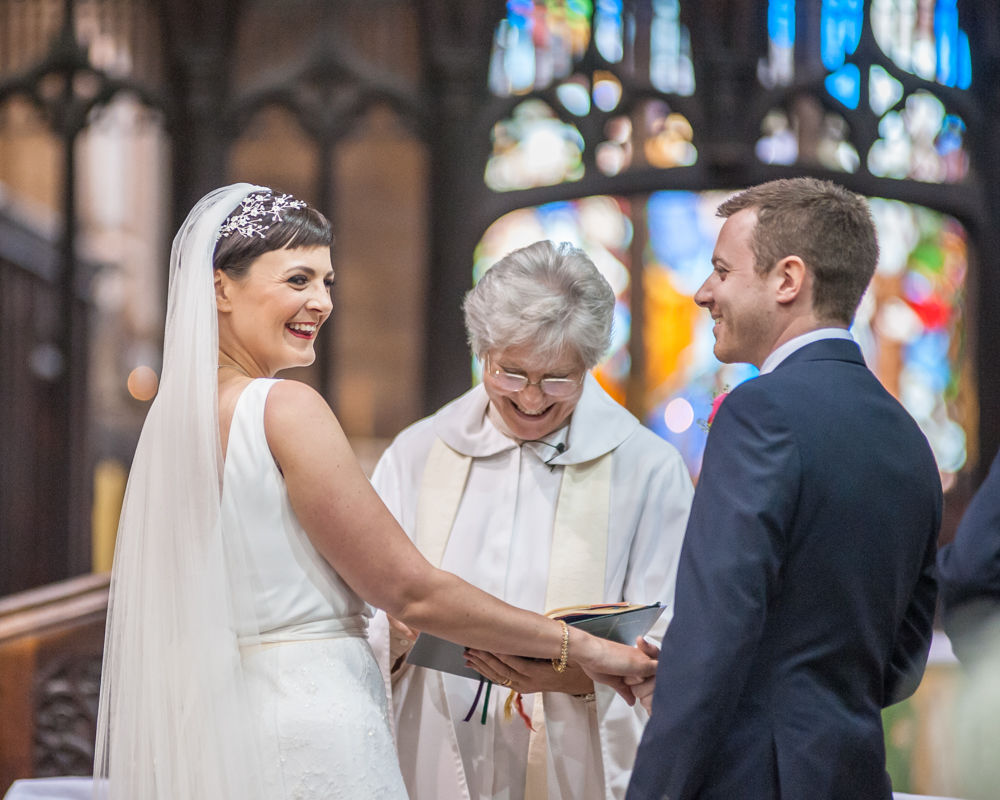 Bride laughing in ceremony, St Mary's Ecclesfield, Sheffield