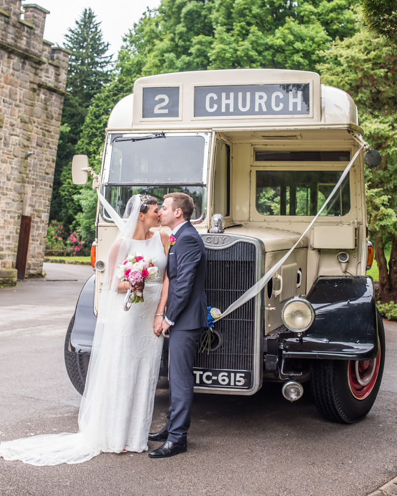 Bride and Groom outside vintage bus, Sheffield wedding photographers, Whirlowbrook Hall