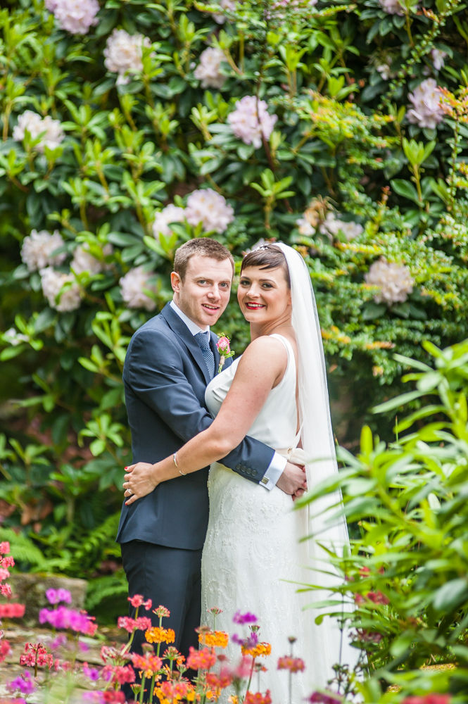 Bride and groom in flower grounds, Sheffield wedding photographers, Whirlowbrook Hall