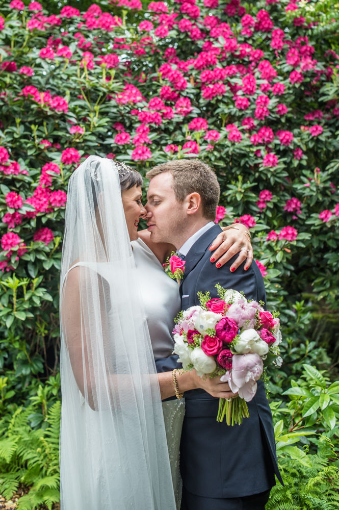 Bride and groom nose to nose, Sheffield wedding photographers, Whirlowbrook Hall
