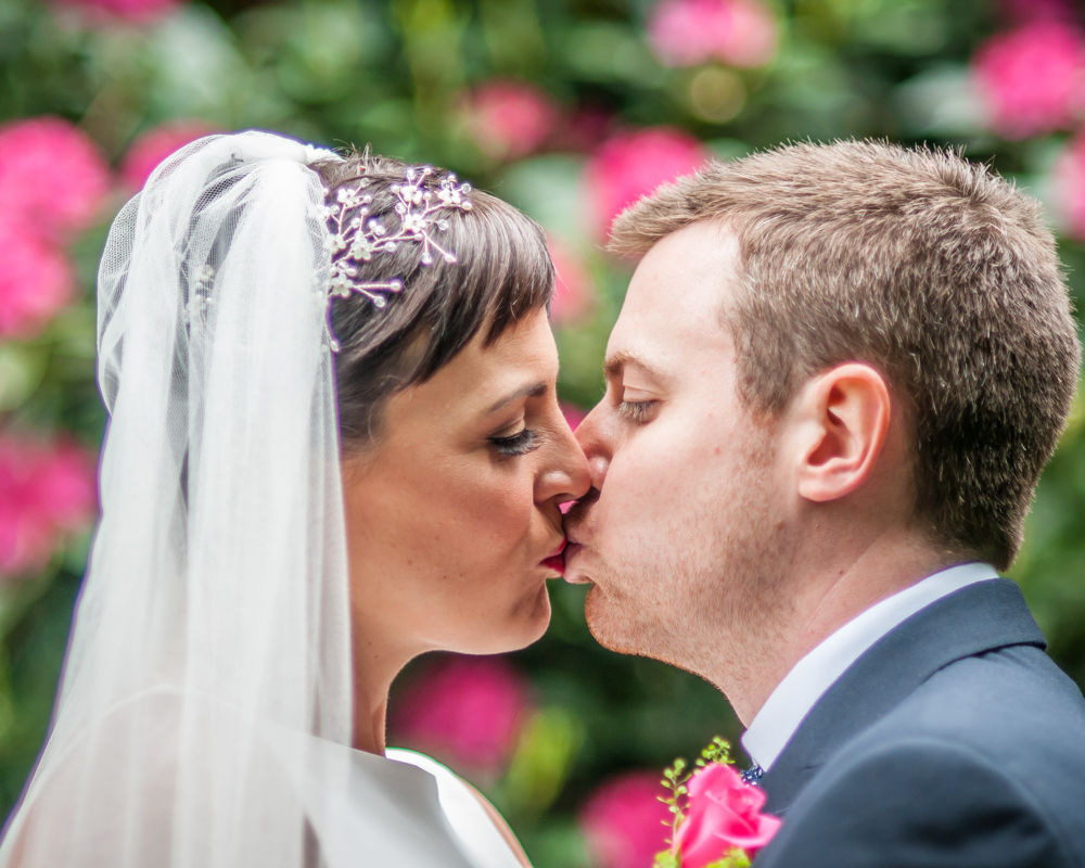 Bride and groom kisses, Sheffield wedding photographers, Whirlowbrook Hall