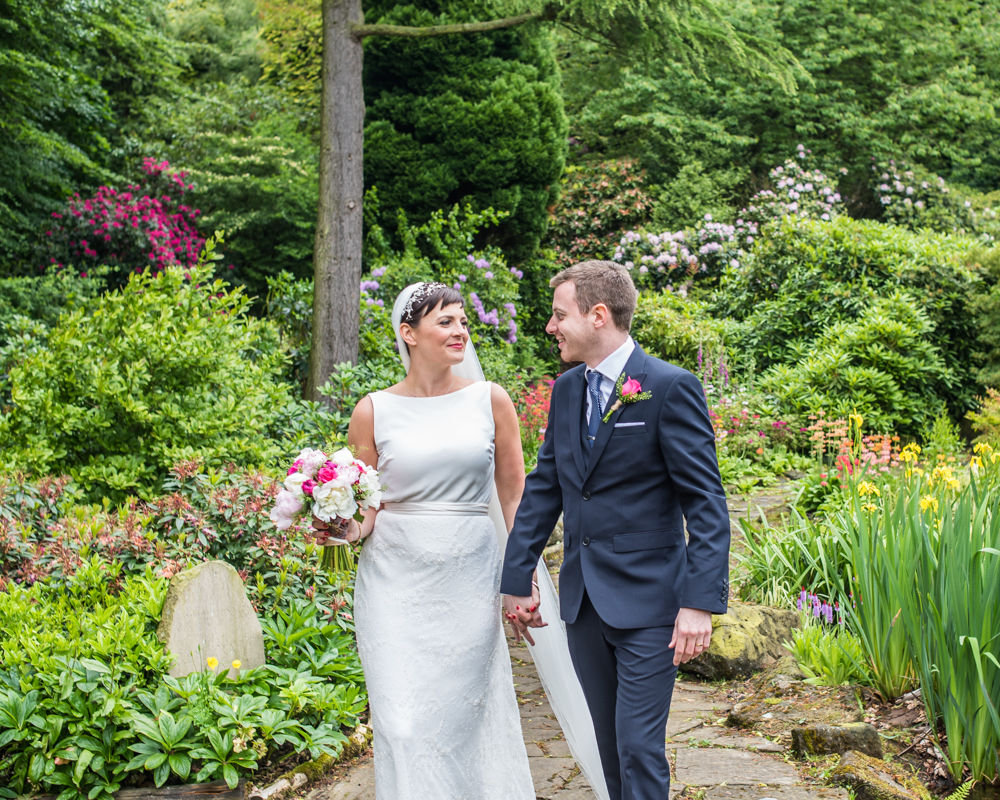 Bride and groom walking in grounds, Sheffield wedding photographers, Whirlowbrook Hall