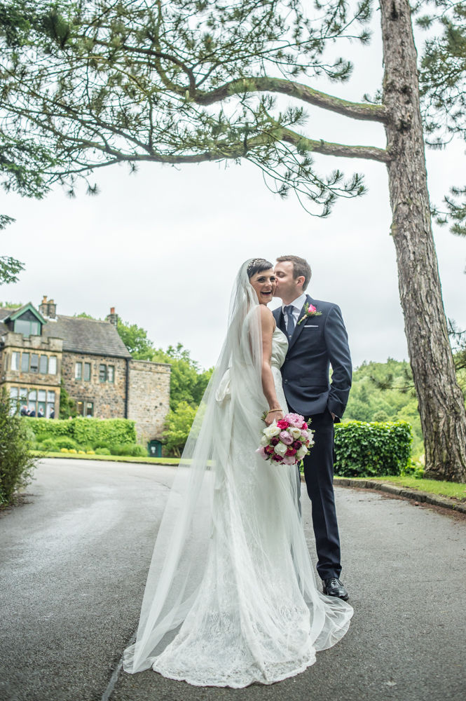 Bride and groom posing outside Whirlowbrook Hall, Sheffield wedding photographers, Whirlowbrook Hall