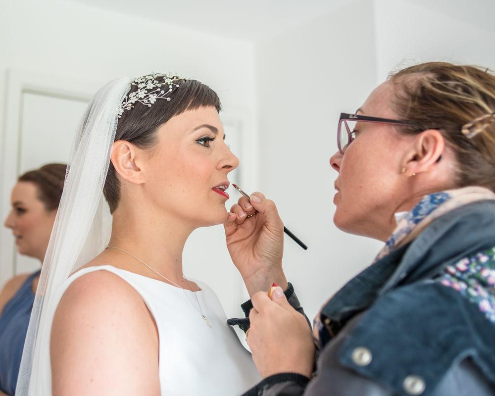 Bride getting lipstick finished, Sheffield wedding photographer