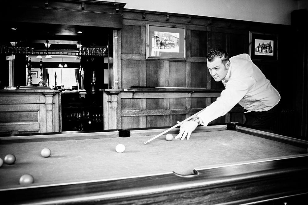 Groom playing pool before wedding, Chatsworth wedding photographers