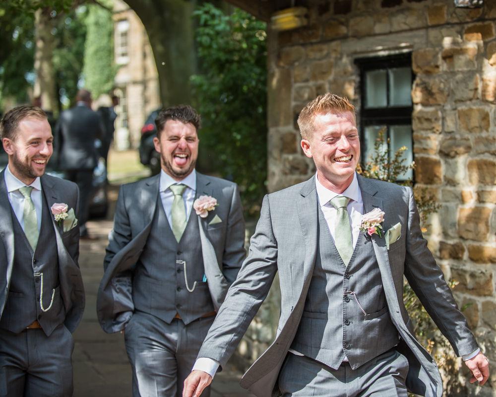 Happy groomsmen on way to wedding, Mosborough Hall wedding