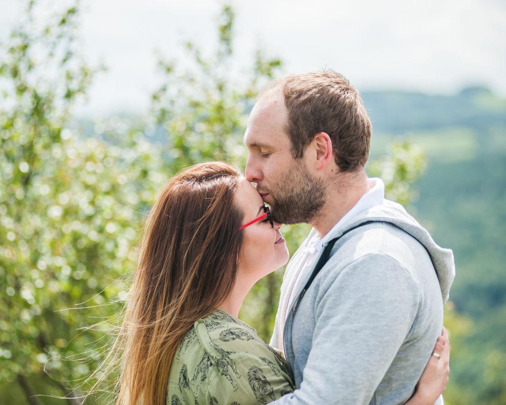 Max kissing Louisa on head - Sheffield wedding photographers