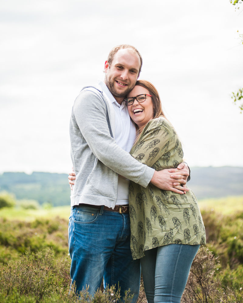 Laughing on pre-wedding photo shoot, Surprise View, Peak District