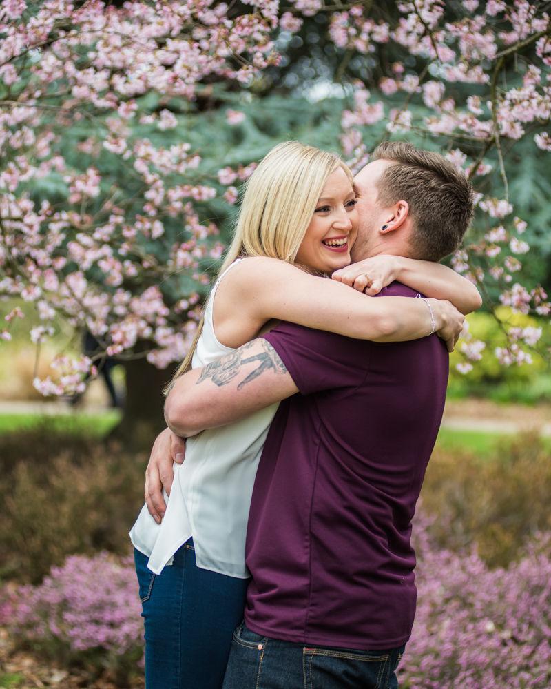 Lifting Deanna up, Botanical Gardens Sheffield wedding photographers