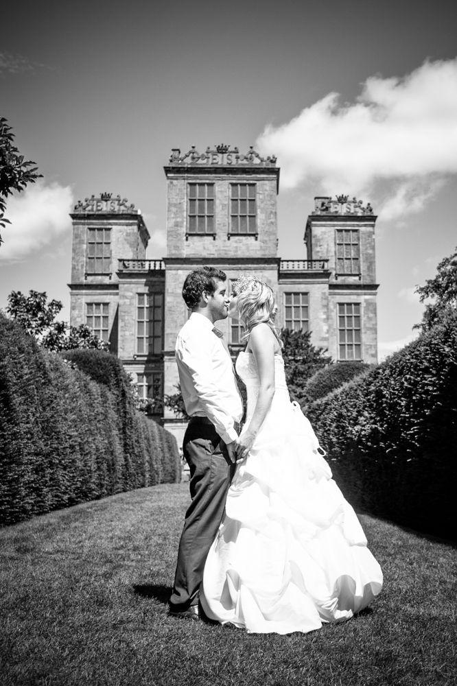 Hardwicjk Hall bride and groom kissing, Sheffield wedding photographer