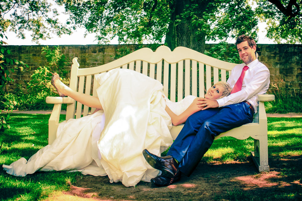 Bride and Groom on bench, Sheffield wedding photographers