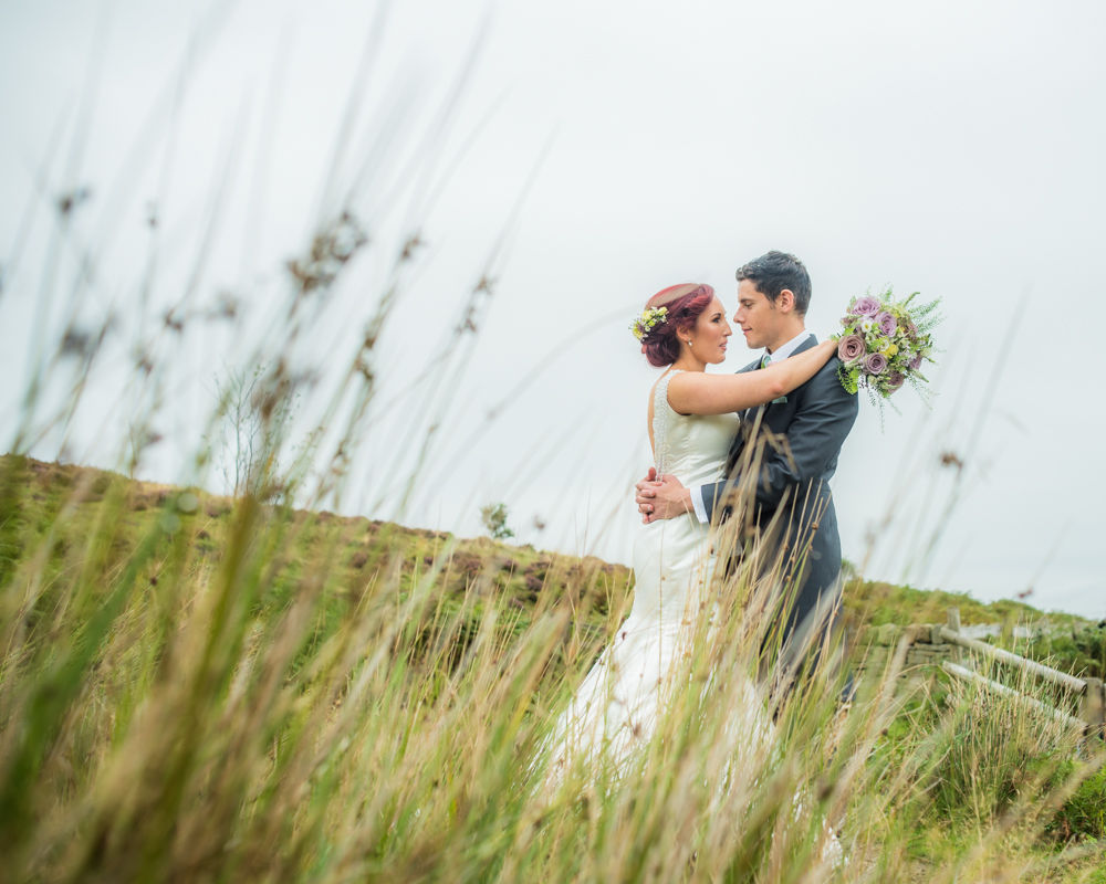 Kiss through long grass, Sheffield wedding photographers