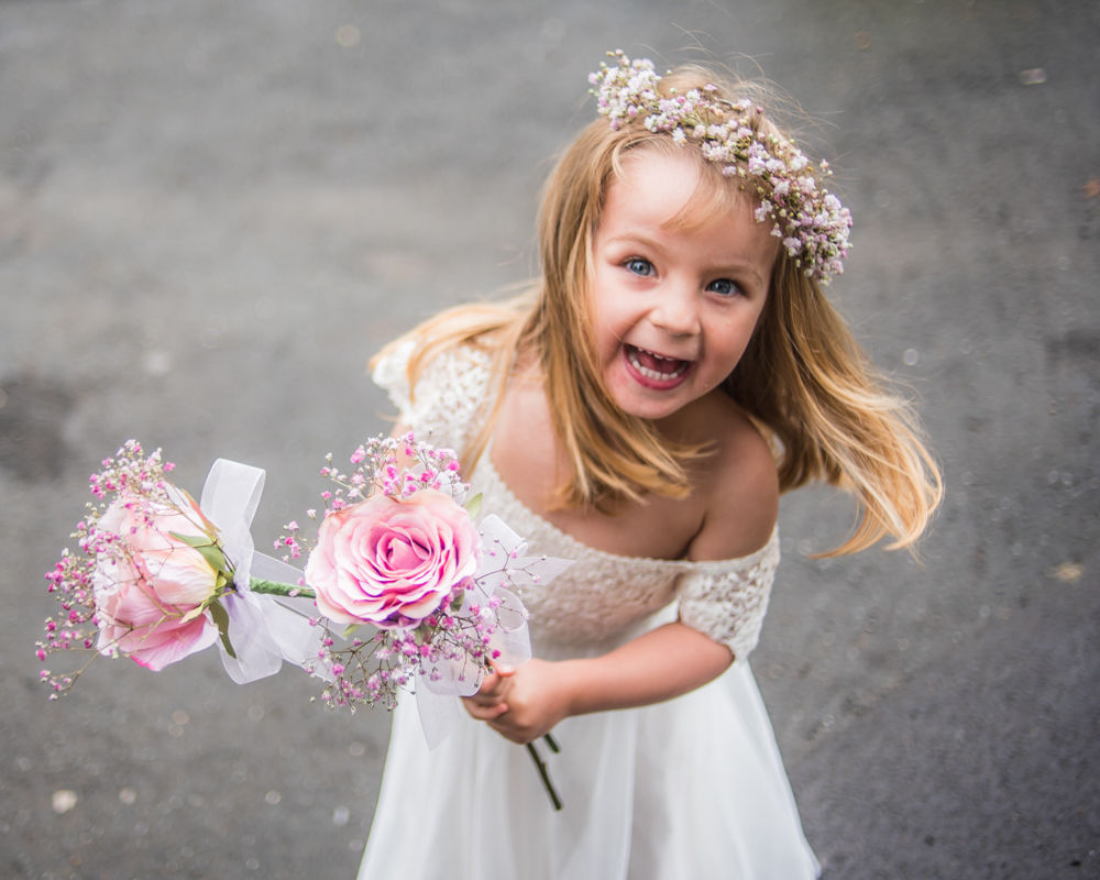 Flowergirl about to go into church, Sheffield wedding photographers