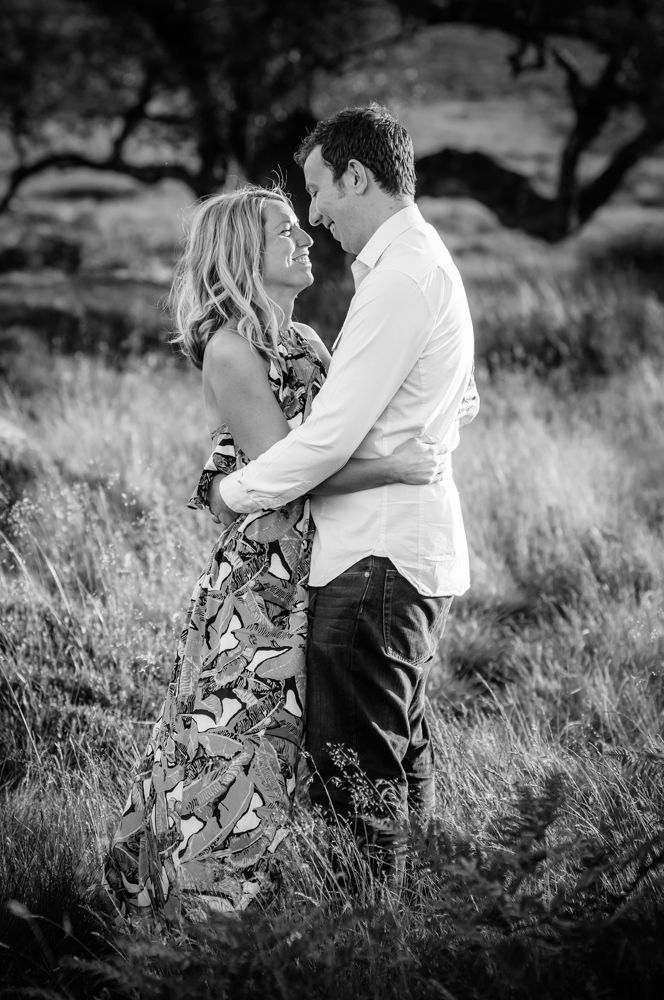 Cuddles in long grass, Sheffield wedding photographers