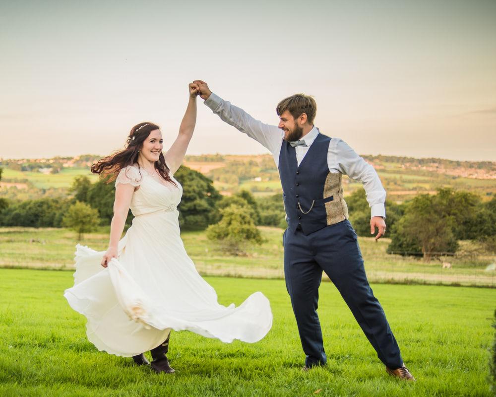 Groom twirling bride,  Wentworth Castle Garden wedding, Sheffield photographers