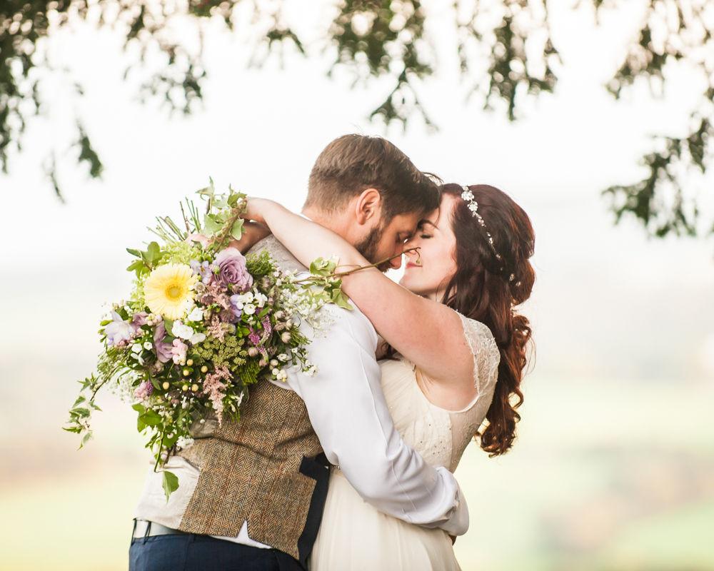 Eskimo bride and groom kiss, Wentworth Castle Garden wedding, Sheffield photographers