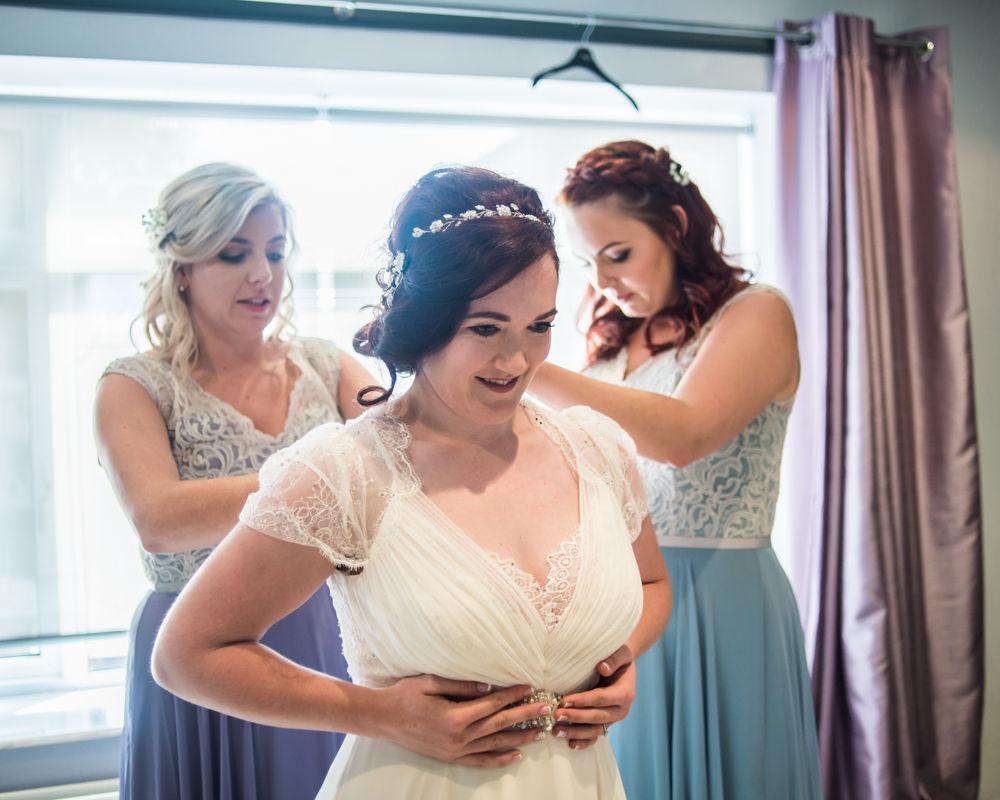 Bride getting in dress,  Wentworth Castle Garden wedding, Sheffield photographers