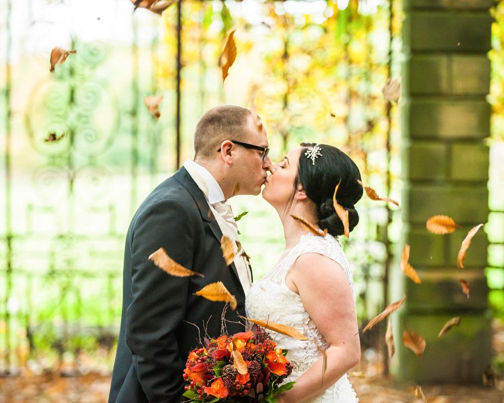 Kisses unfer fallen leaves, Wortley Hall wedding, Sheffield wedding photographers